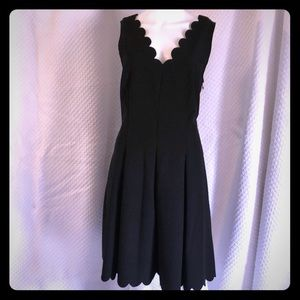 Little black dress with scalloped trim
